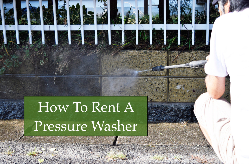 Image of a man using a pressure washer rental