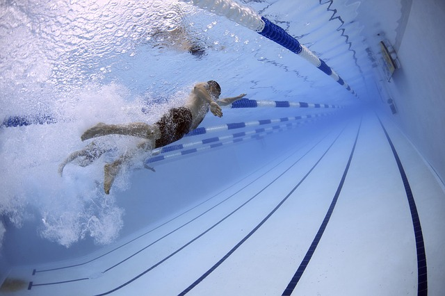 clean underwater pool image with swimmer
